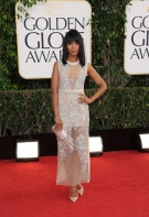 She is one of my favorite actresses. Kerry rocks the fringe and straight hair in a sheer Miu Miu dress.