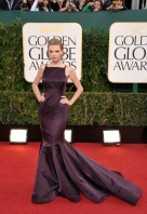 Boy does she know how to deal with a breakup. Taylor Swift looks heavenly in a deep purple gown by Donna Karan Atelier.