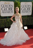 I have to say I think this gown is a bit too much for the Globes. Especially when she isn't even a nominee.