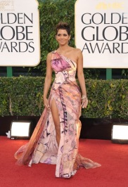 Look at that leg. Halle Berry pulls an Angelina on the red carpet in her statement floral gown.