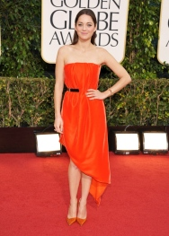 The side high low and vibrant orange look magnificent on Ms. Cotillard.